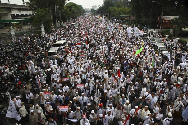 "JAKARTA, INDONESIA - NOVEMBER 4: Thousands of people comprised of Islamic-based groups take a rally during a protest in Jakarta, Indonesia, on November 04, 2016 in respond to Jakarta Governor, Basuki ""Ahok"" Tjahaja Purnama alleged religious defamation about Surah al-Maidah verse 51 of the Quran. The protesters demand Indonesian Police to process the report filed against the governor. The Tribe-Religion-Race (SARA) issue is an sensitive issues in Indonesia which had been warned since new-regime era. Agoes Rudianto / Anadolu Agency"